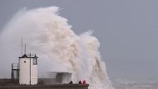Waves crash over the sea wall at Porthcawl
