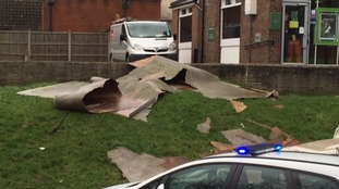 Wind blows off bank roof