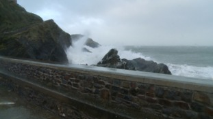Waves crash into the sea wall at Ilfracombe