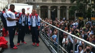 Team GB athletes prepare for launch on the victory convoy's first float.