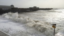 Powerful waves battered the shoreline in Hastings in East Sussex as Storm Imogen brought gale-force winds to the southern region.