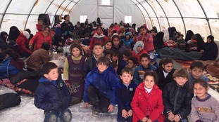 Children and their families were held in the temporary tents awaiting clearance into Turkey in temperatures that have dropped to nearly 0C.