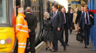 The Queen boards at train at King's Lynn station.