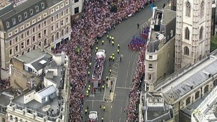 Thousands line the streets as athletes pass by