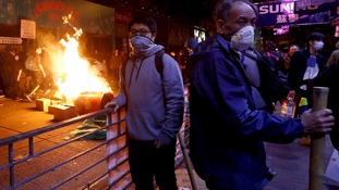 Hong Kong: Police use pepper spray and batons to disperse Mong Kok street vendor protesters