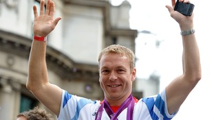 Sir Chris Hoy waves to the crowds during a parade passed Mansion House