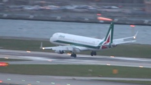 Dramatic moment pilot aborts landing while being battered by storm