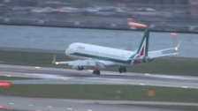 Pilot aborts landing while being battered by high winds