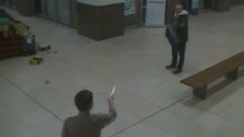 Dramatic video as knifeman threatens off-duty policeman in shopping centre.