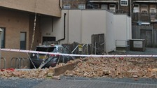 Car crushed by falling building