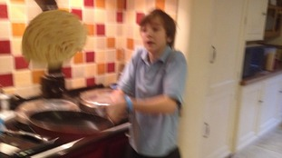 Matt Woodland flipping a pancake