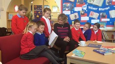 Children from Torpoint Infant School reading to Dame Esther Rantzen.
