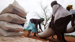 Villagers in Zimbabwe collect their monthly food ration provided by the United Nations World Food Programme.