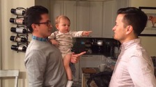Adorable baby left baffled by dad's identical twin