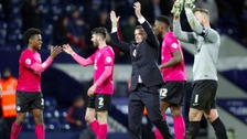 Peterborough United celebrate their draw at The Hawthorns.