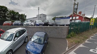 'Group of men' ransacked the premises before making off with five vehicles