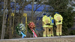 Tributes left at the scene of the crash which killed 11 and injured 80.