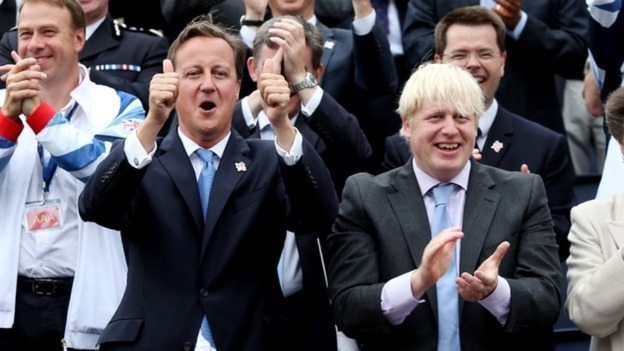 Prime Minister David Cameron and Mayor of London Boris Johnson cheer on the Olympic athletes as they take part in a parade through London
