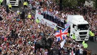 The crowd in Trafalgar Square cheer on the athletes.