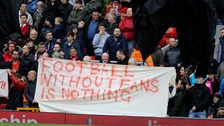Fans hold up banners protesting against ticket prices during the Barclays Premier League match at Anfield, Liverpool.