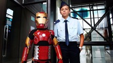 Iron Boy saves reporter in daring rescue mission