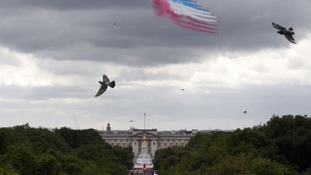 The famous red, white and blue smoke in the sky over central London watched by thousands