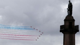 The Red Arrows fly past London's landmarks
