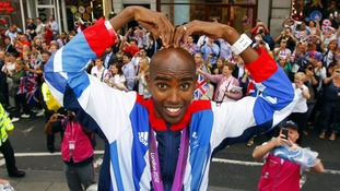 Mo Farah does the 'Mobot' as he takes part in a parade through London