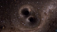Graphic depicting two circling black holes giving off gravitational waves