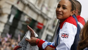 Heptathlete Jessica Ennis looks at the parade crowds