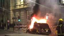 Dramatic pictures show black cab engulfed in flames