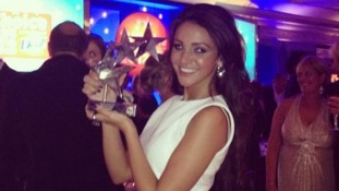 Michelle Keegan holds up her Best Soap Actress gong at the TV Choice Awards