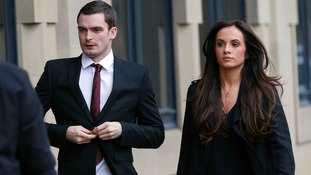 Adam Johnson arrives at Bradford Crown Court with with partner Stacey Flounders.