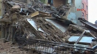 Clouds of brown dust was reported to have swept into the surrounding streets after the collapse.
