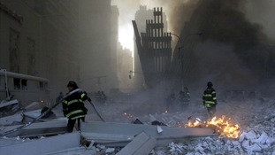 Firemen work around the World Trade Center after both towers collapsed in New York on September 11, 2001