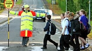A headteacher works as a volunteer lollipop lady after education bosses cut funding for a crossing patrol in Suffolk