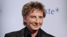 Barry Manilow 'out of surgery and doing well'