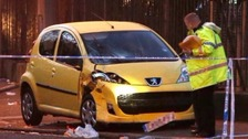 A car is examined at the scene