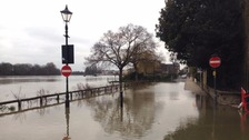 Flood warnings in place after Thames bursts banks