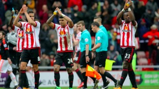 Sunderland's Lamine Kone celebrates with team-mates after the win