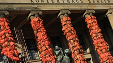 Ai Weiwei covers Berlin landmark in used life jackets