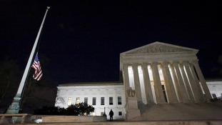 The US flag outside the Supreme Court flies at half-mast following the death of Justice Antonin Scalia