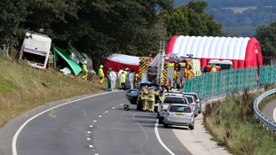 Emergency services at the scene the coach crash on the A3 near Hindhead in Surrey