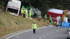 Emergency services at the scene of the coach crash on the A3 near Hindhead in Surrey