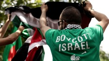 A Pro-Palestinian demonstrator at a boycott Israel rally in Paris
