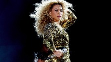 Beyonce performing on the Pyramid Stage at the Glastonbury Music Festival.