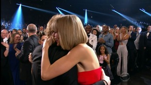 Ed Sheeran gets a hug from friend Taylor Swift.