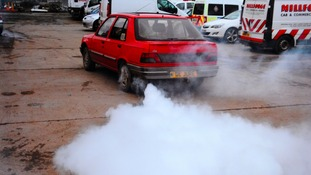 Speeding driver used James Bond-style smokescreen in a bid to shake off police