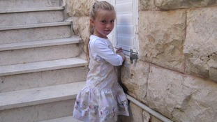 Eight-year-old Miriam Monsonego, daughter of school headmaster Rabbi Yaacov