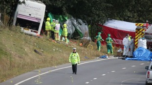 Emergency services at the scene the coach crash on the A3 near Hindhead in Surrey.